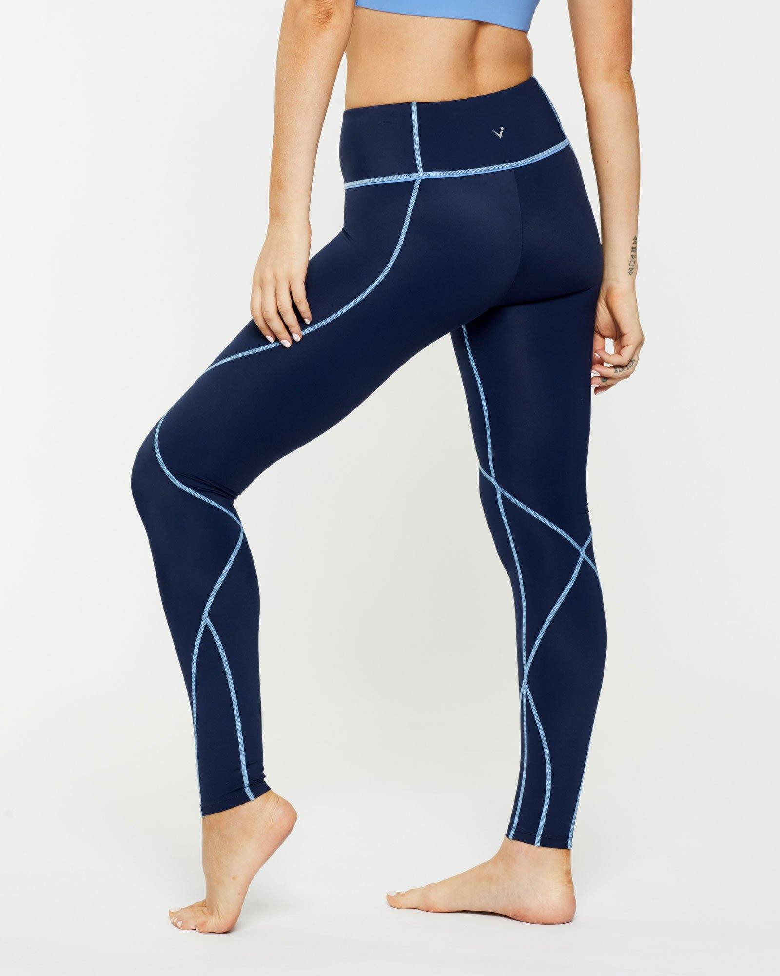 Femininely Vastus mid waist long Navy legging with contrast stitching, side view, for pilates, barre, yoga, gym and studio workouts