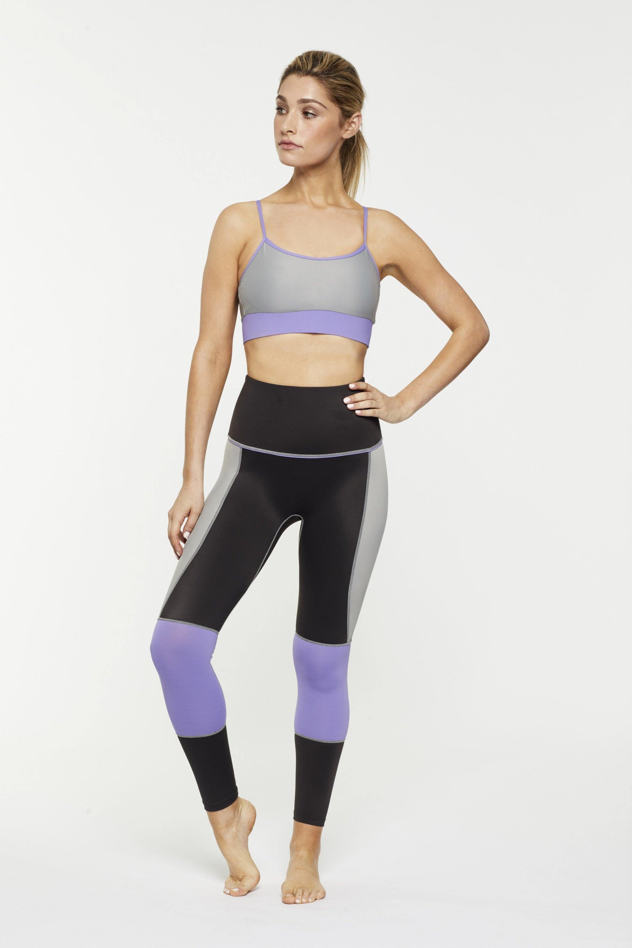 STEELY GRACILIS 7/8 HIGH WAISTED LEGGING LIQUORICE GREY WITH CONTRAST PANELS WORN WITH INFRASPINATUS BRA TOP, FRONT VIEW