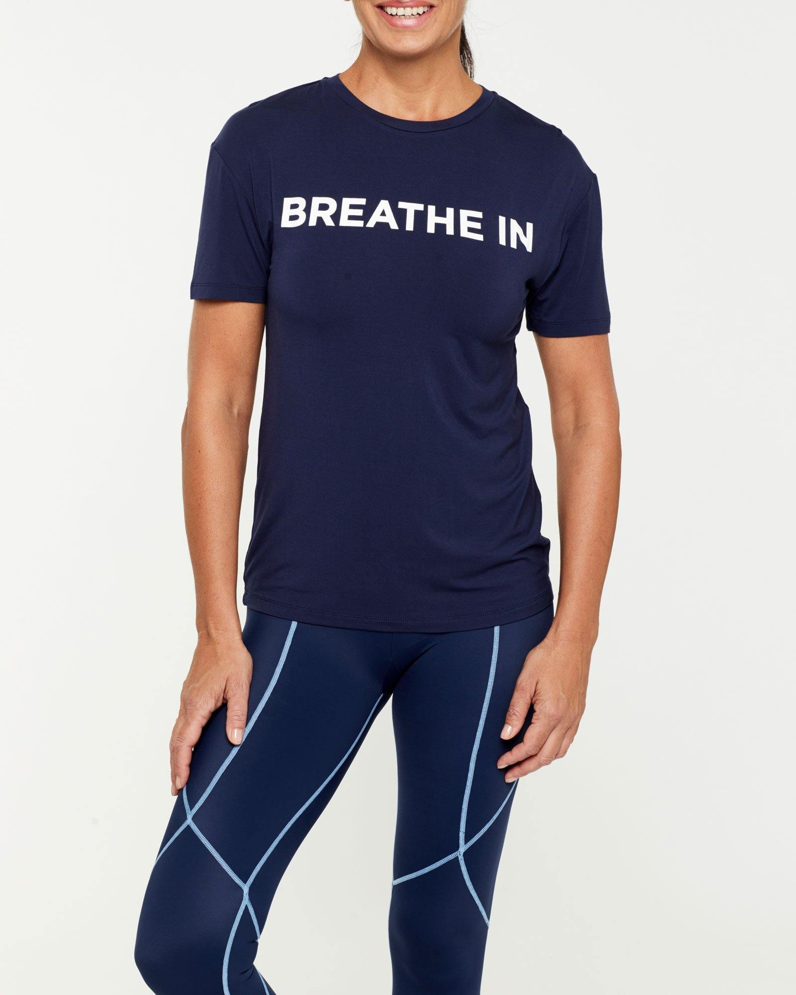 Femininely SCAPULAE Bamboo T-SHIRT, Navy blue WITH WHITE MESSAGING, WORN WITH VASTUS LEGGING, FRONT VIEW