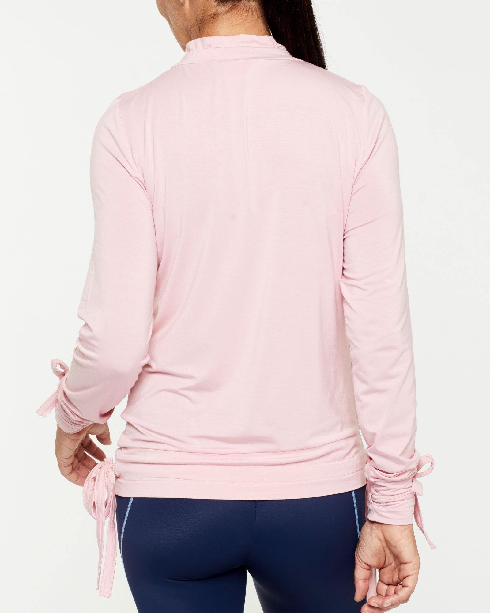 Femininely Spinae long sleeve adjustable top with self ties, in pink bamboo worn with Vastus mid waist full length legging, back view