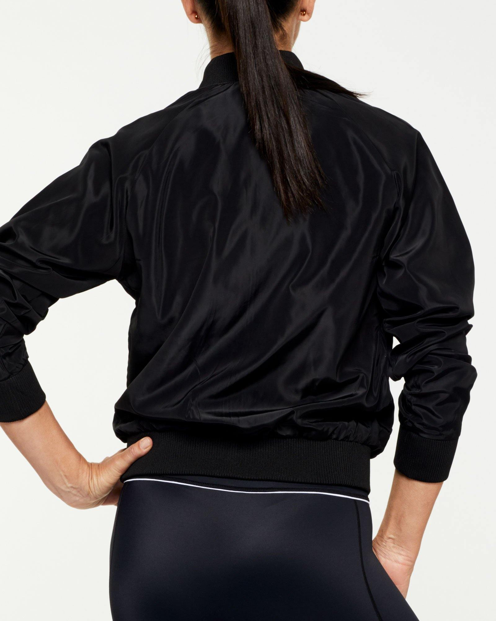 COMPANION PIKE REVERSIBLE JACKET, BLACK OUTER,  WHITE INNER, WORN WITH GRACILIS 7/8 LEGGING AND INFRASPINATUS ACTIVE TOP, BLACK BACK VIEW