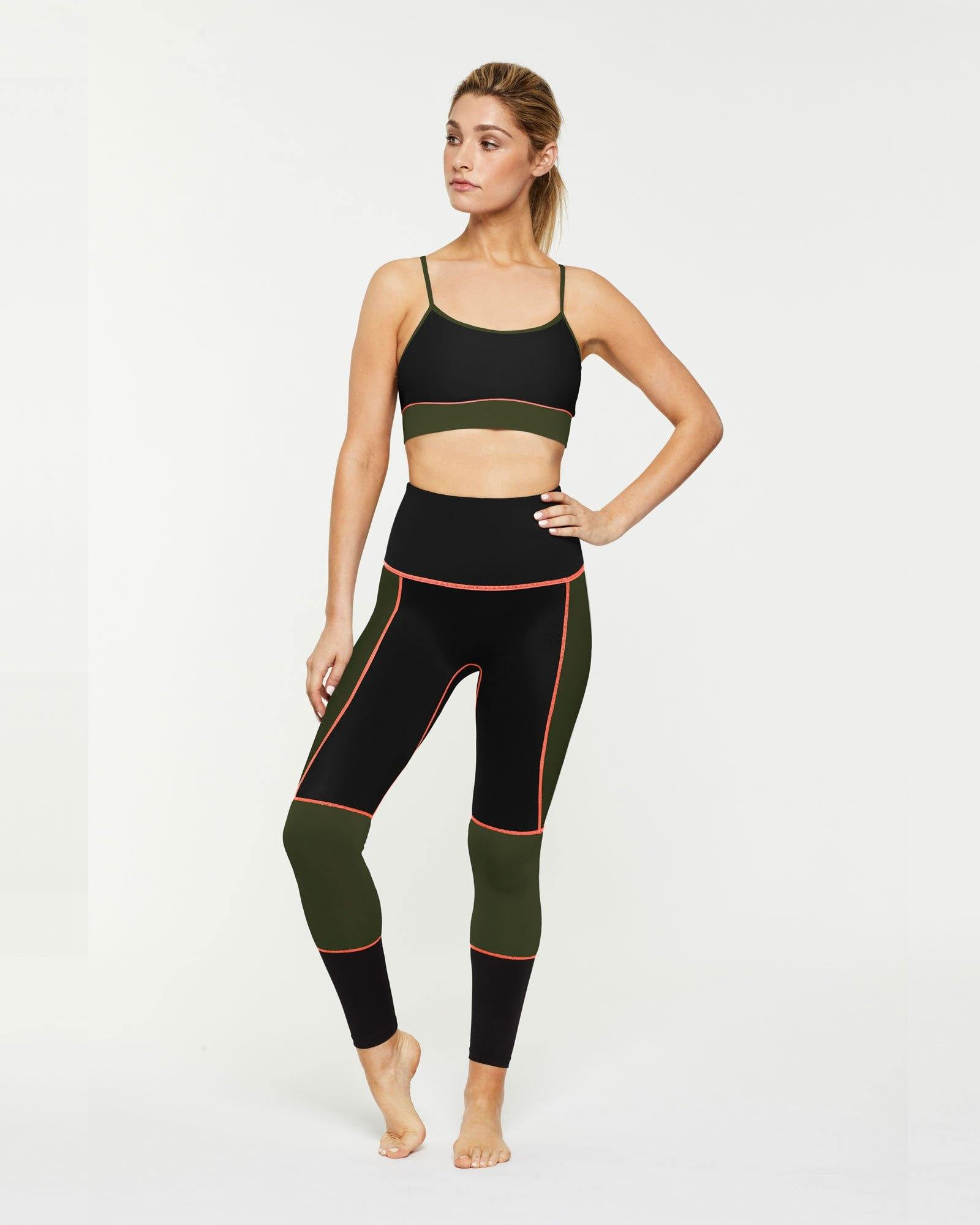 Sergeant Olive GRACILIS 7/8 HIGH WAISTED LEGGING Black WITH CONTRAST PANELS in dark Olive and contrast orange stitching worn with Infraspinatus bra top, front VIEW for pilates, barre, yoga, dance, gym-workouts