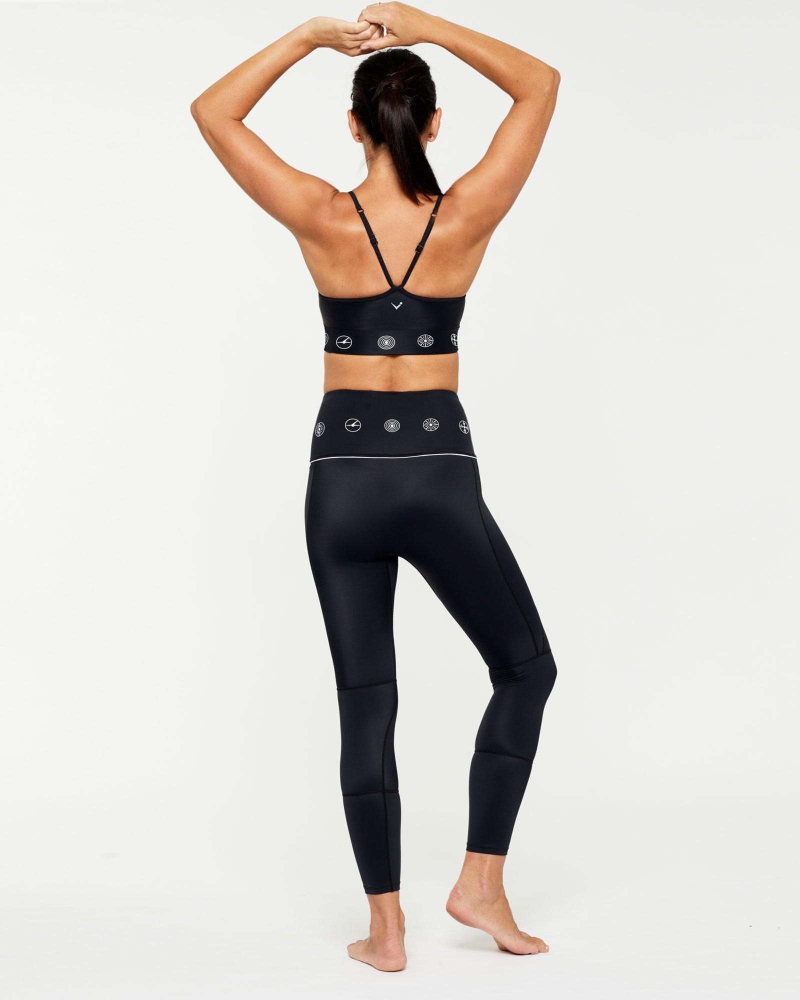 Companion GRACILIS 7/8 LEGGING BLACK WITH WHITE SYMBOLS WORN WITH INFRASPINATUS BRA TOP, CORE BACK VIEW
