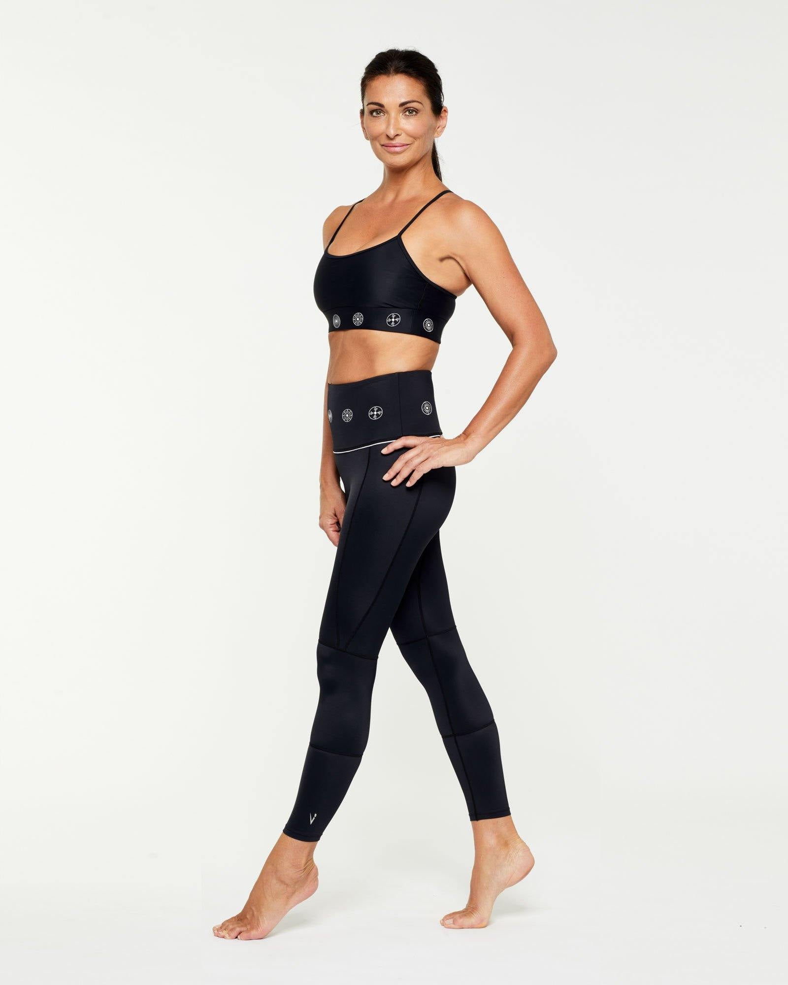 Companion GRACILIS 7/8 LEGGING BLACK WITH WHITE SYMBOLS WORN WITH INFRASPINATUS bra top, SIDE VIEW