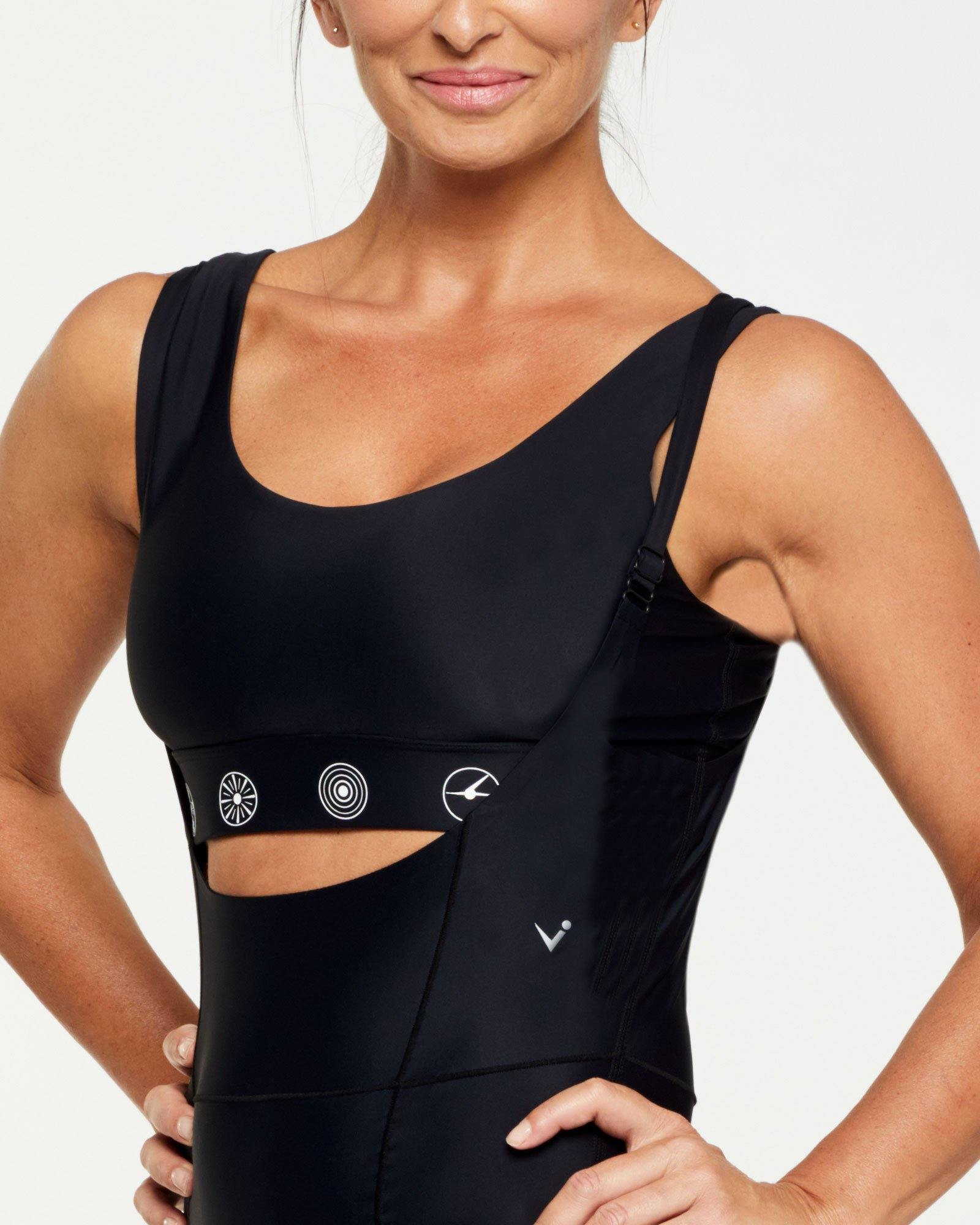 Companion RECTUS SHORT BODYSUIT worn low front with Pectoralis active top black with white symbols, high back, side view