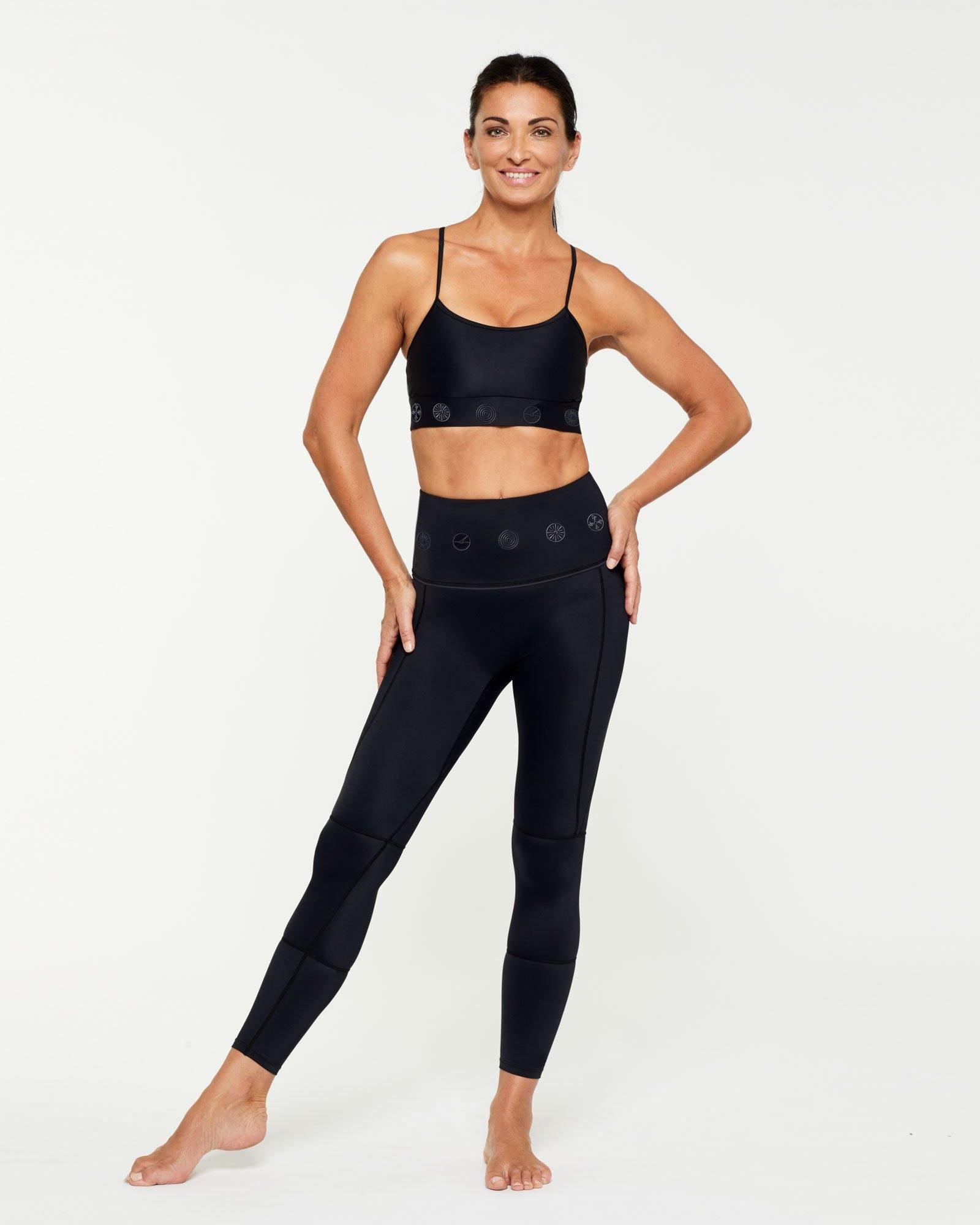 Companion Infraspinatus Bra top worn with GRACILIS 7/8 LENGTH LEGGING BLACK WITH BLACK SYMBOLS, FRONT VIEW