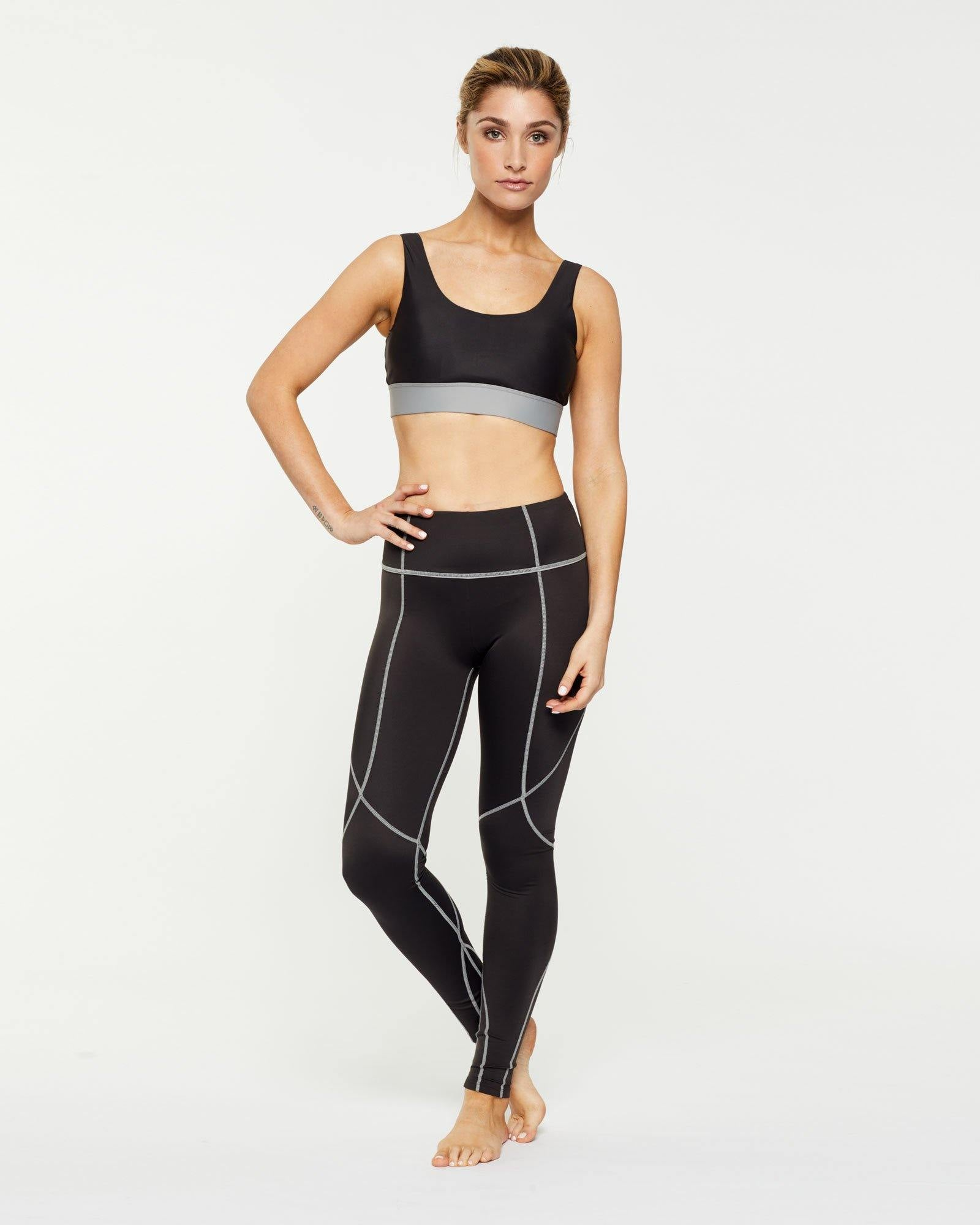 Steely Pectoralis crop bra top worn with Vastus mid waist long legging, front view