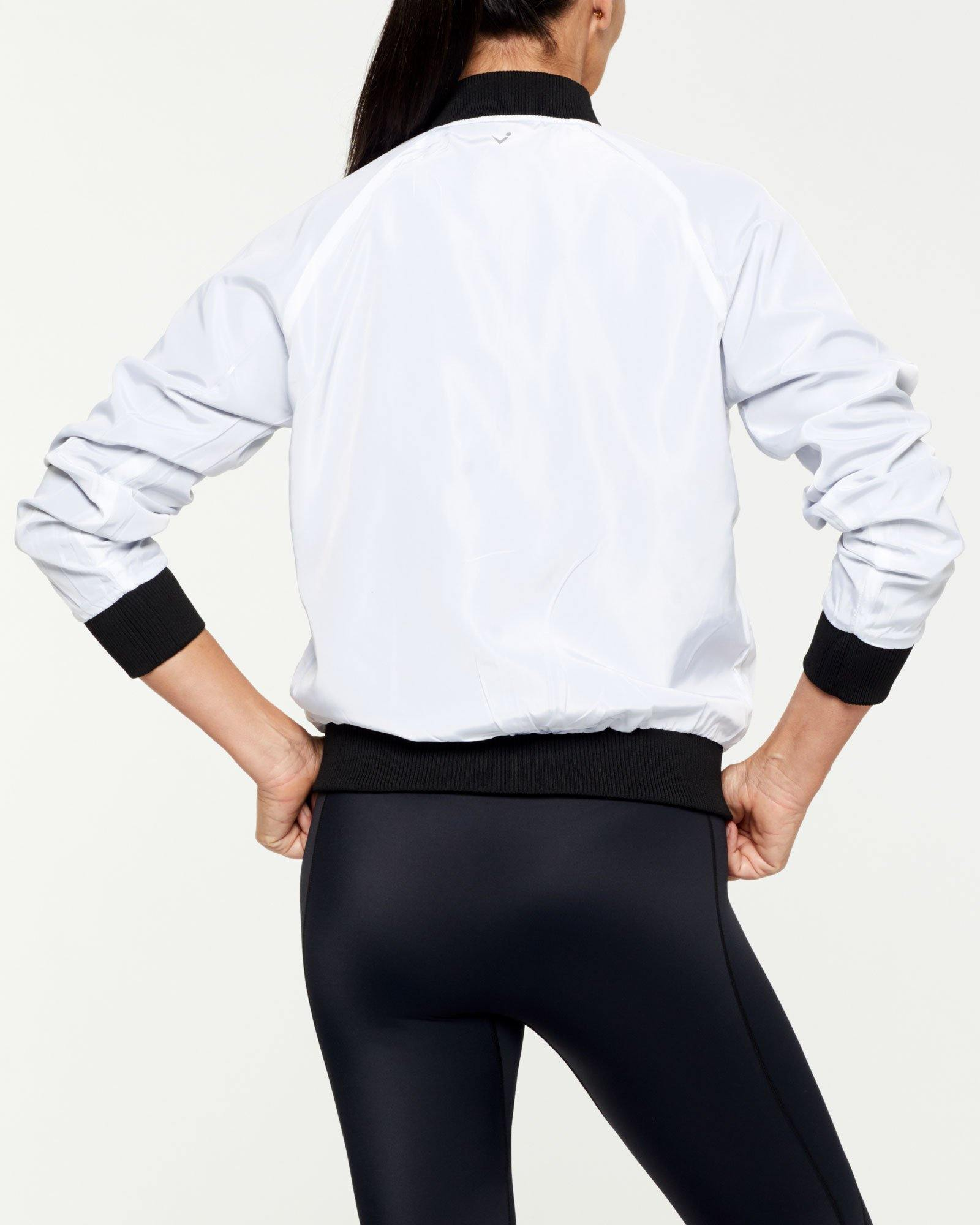 COMPANION PIKE REVERSIBLE JACKET, BLACK OUTER,  WHITE INNER, WORN WITH GRACILIS 7/8 LEGGING AND INFRASPINATUS ACTIVE TOP, WHITE BACK VIEW