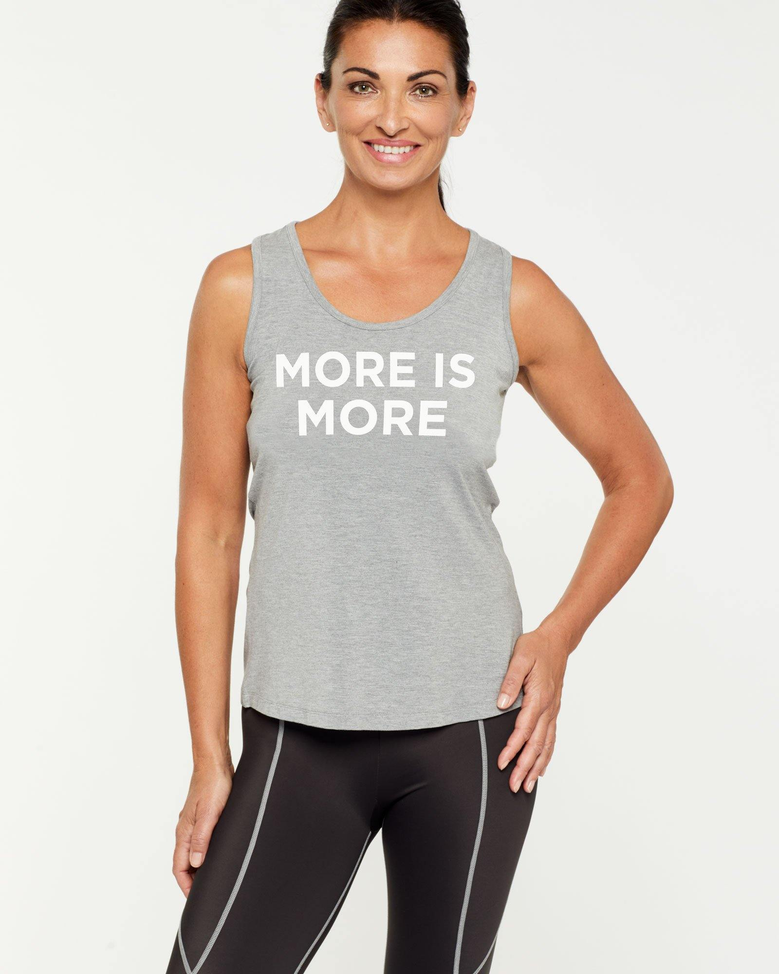 STEELY RHOMBOIDEUS LIGHT GREY TANK TOP, MORE IS MORE message on front in white, worn with Vastus mid-waist full length legging, front view