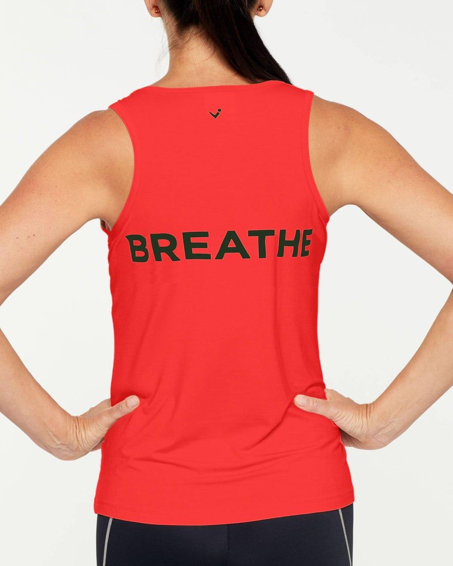 Sergeant Olive RHOMBOIDEUS Clementine orange TANK TOP,  message on front in khaki reads MORE CORE and on the back message is BREATHE, front view. Great for yoga, pilates, barre, physicore and all gym workouts