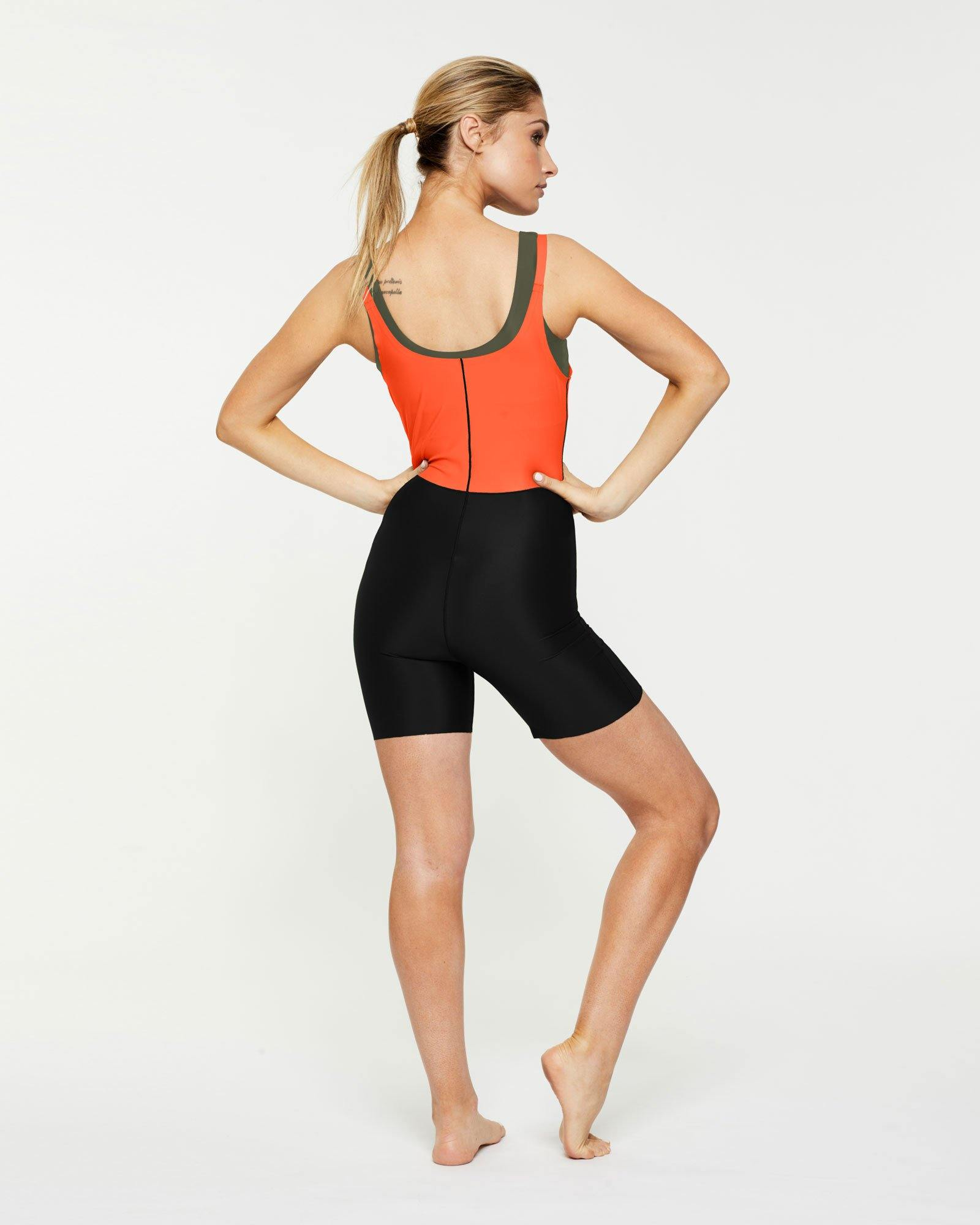 Sergeant Olive Rectus short Bodysuit worn low front over Pectoralis active top and high back, back view for pilates, barre, dance, yoga, gym workout, black and orange