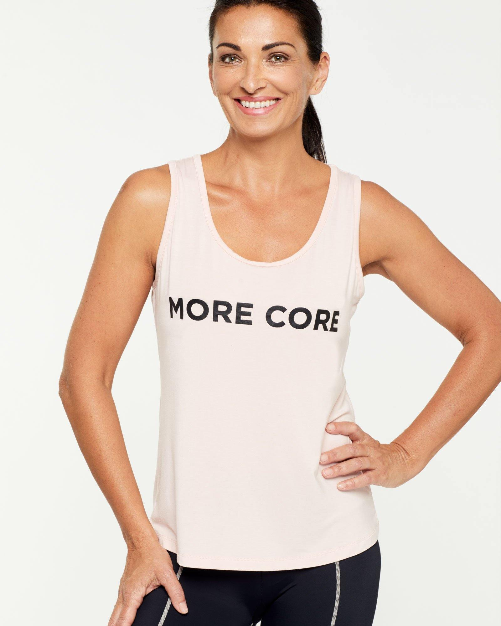 Warrior, RHOMBOIDEUS PINK TANK TOP, MORE CORE message on front in black, front view