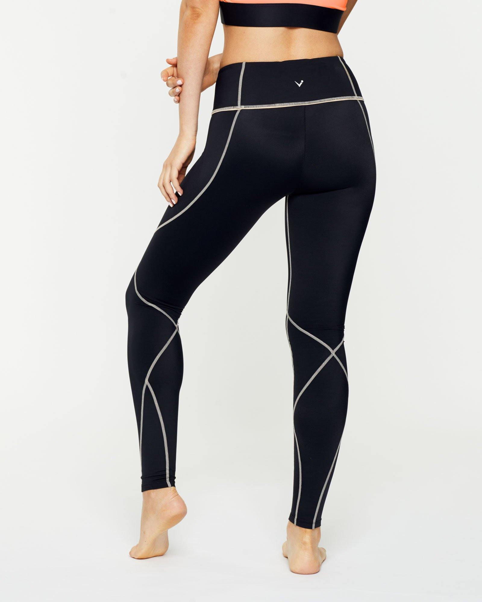 Warrior Vastus mid waist full length legging with contrast stitching, back view