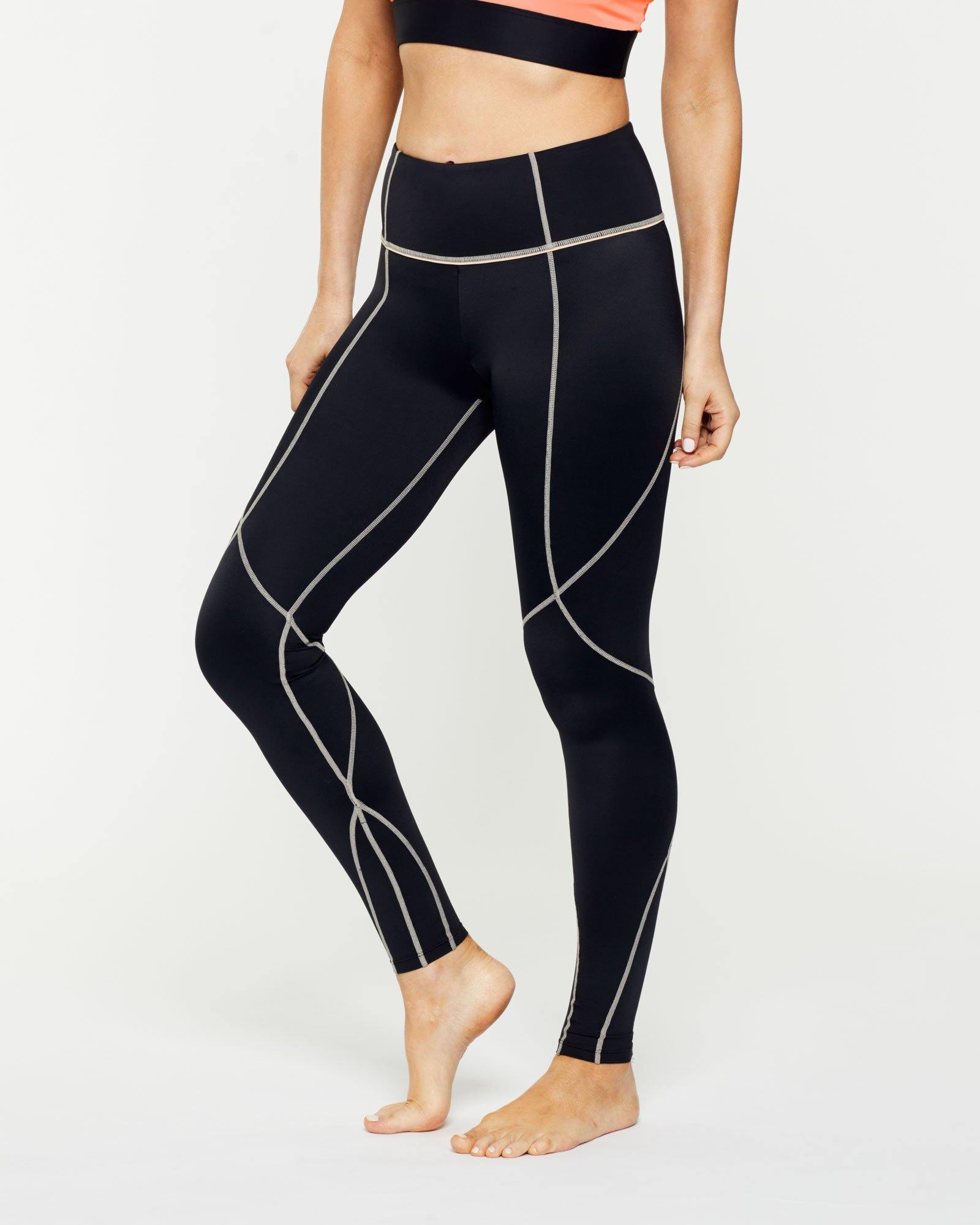 Warrior Vastus mid waist full length legging with contrast stitching, side view