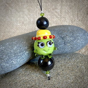 "Hangable EMF Accessory w/Shungite, Lime Green ""Squeedle"" in Yellow Hat"
