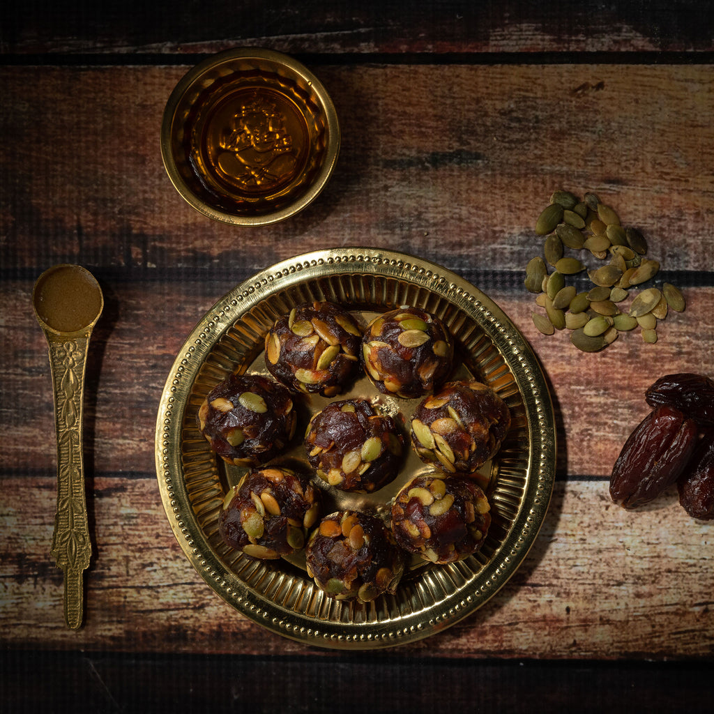 Dates, pumpkin seeds maple syrup laddu