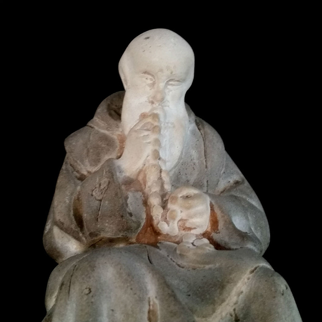Monk Kissing His Rosary Statue - The Vintage Catholic