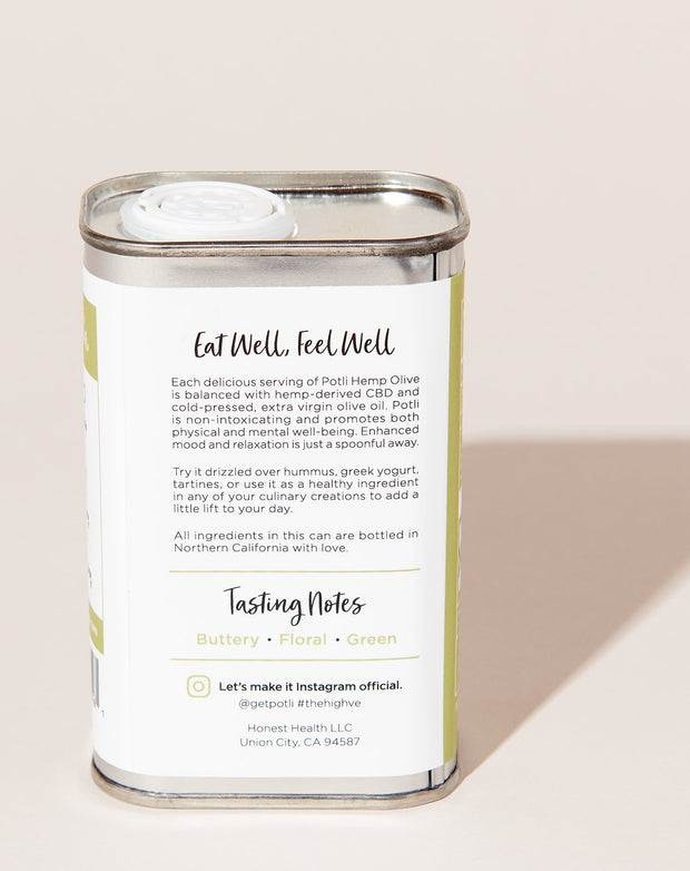 "The back of a Potli hemp infused olive oil tin, which reads ""Eat well, feel well"" and features tasting notes that read buttery, floral, and green."