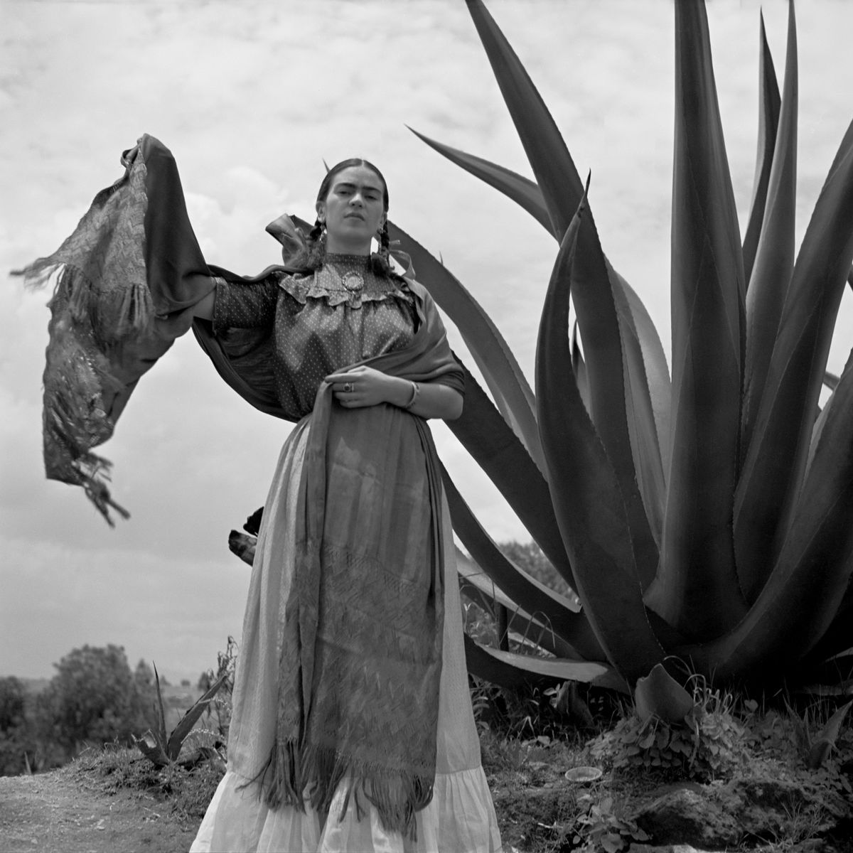 Frida Kahlo standing next to an agave plant, 'Señoras of Mexico' 1937