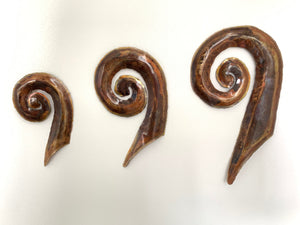 Copper koru artwork