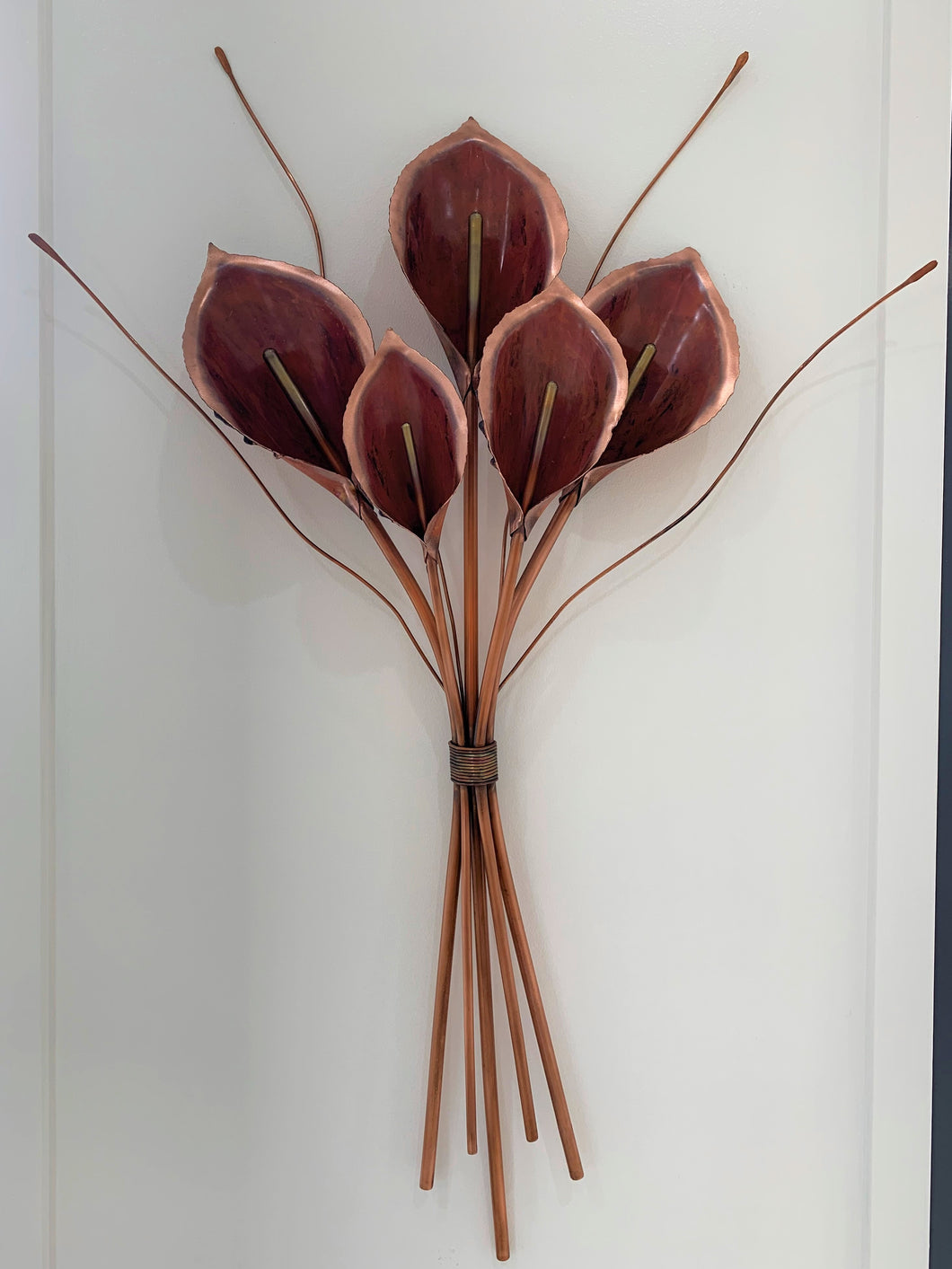 Five copper lilies artwork