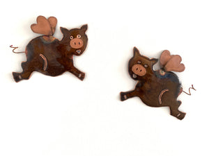 Two flying pigs
