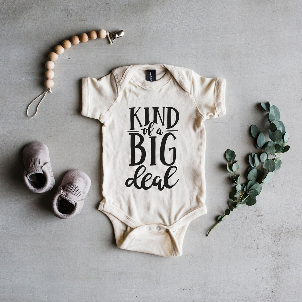 "Cream Short Sleeve ""Kind Of A Big Deal"" Newborn Bodysuit"