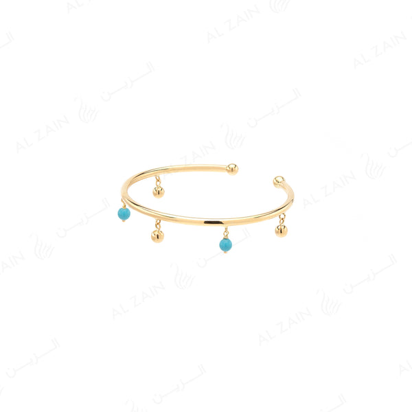 Kids gold ball bangle in yellow gold with hanging turquoise