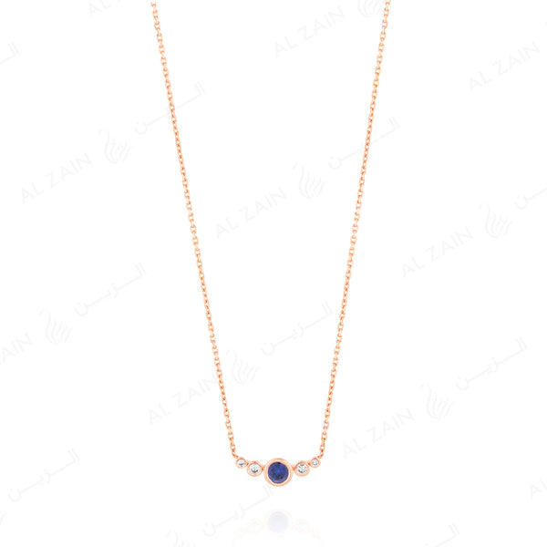 Mystique necklace in rose gold with diamonds and sapphire stone