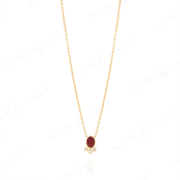 Mystique necklace in yellow gold with diamonds and ruby stone