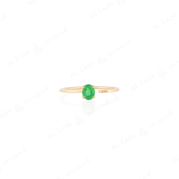 Mystique ring in yellow gold with diamonds and emerald stone