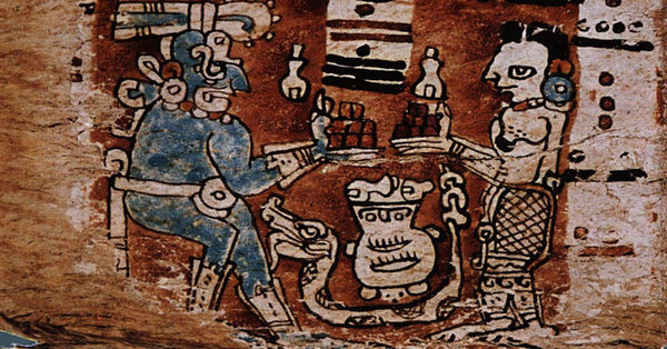 an old piece of art from the Mayan or Incan traditions showing two human like figures holding out plates with brown cubes of whats thought to be cacao