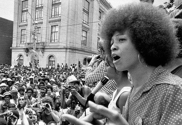 Image of Angela Davis at a protest speaking to a crowd of people