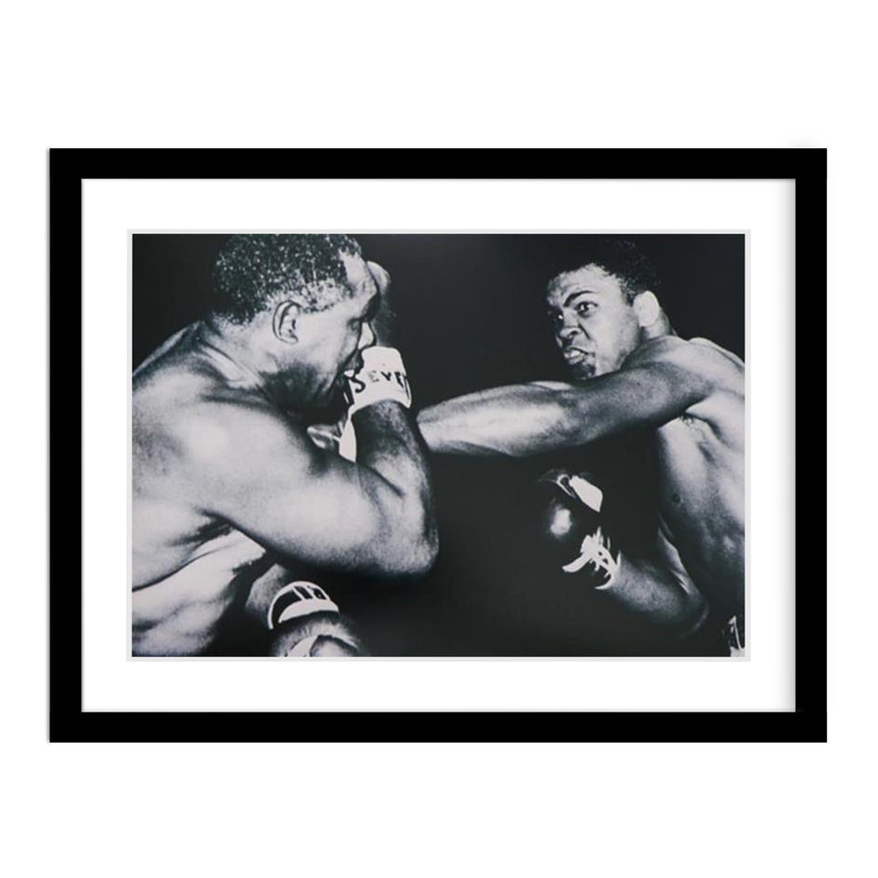 Cassius Clay Defeats Archie Moore Framed Print