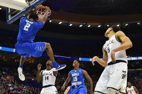 a basketball player jumping up in the air