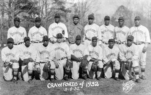 a group of baseball players posing for a photo