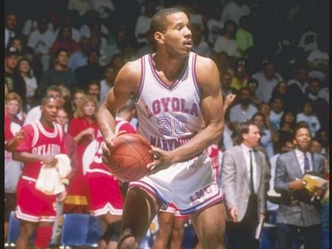 Bo Kimble standing on a basketball court in front of a crowd