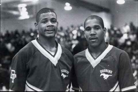 Hank Gathers, Bo Kimble are posing for a picture