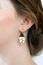 leather and gold accented porcelain earrings