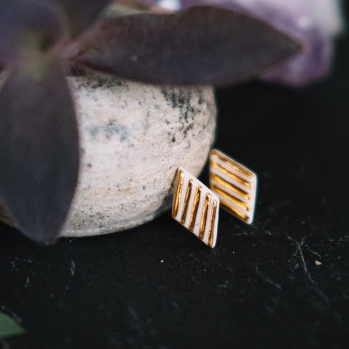 textured golden rhombus porcelain earrings, gold filigree jewelry, white and gold, Austin jewelry, porcelain wearable art, social impact jewelry, ethical accessory