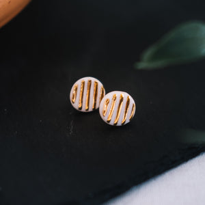 textured golden round porcelain studs, gold filigree jewelry, white and gold, Austin jewelry, porcelain wearable art, social impact jewelry, ethical accessory
