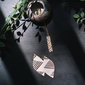 etched leaf earrings with gold accent