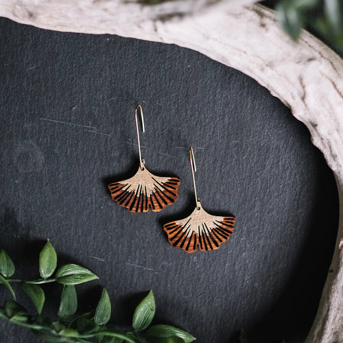 wood ginkgo earrings with gold stem, Austin jewelry, artisan wood wearable art, social impact jewelry, ethical accessory, stained wood tree root jewelry