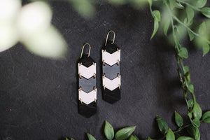 wood and white porcelain chevron hanging earrings, Austin jewelry, porcelain wearable art, social impact jewelry, ethical accessory, black and white wooden jewelry, grey and white earrings
