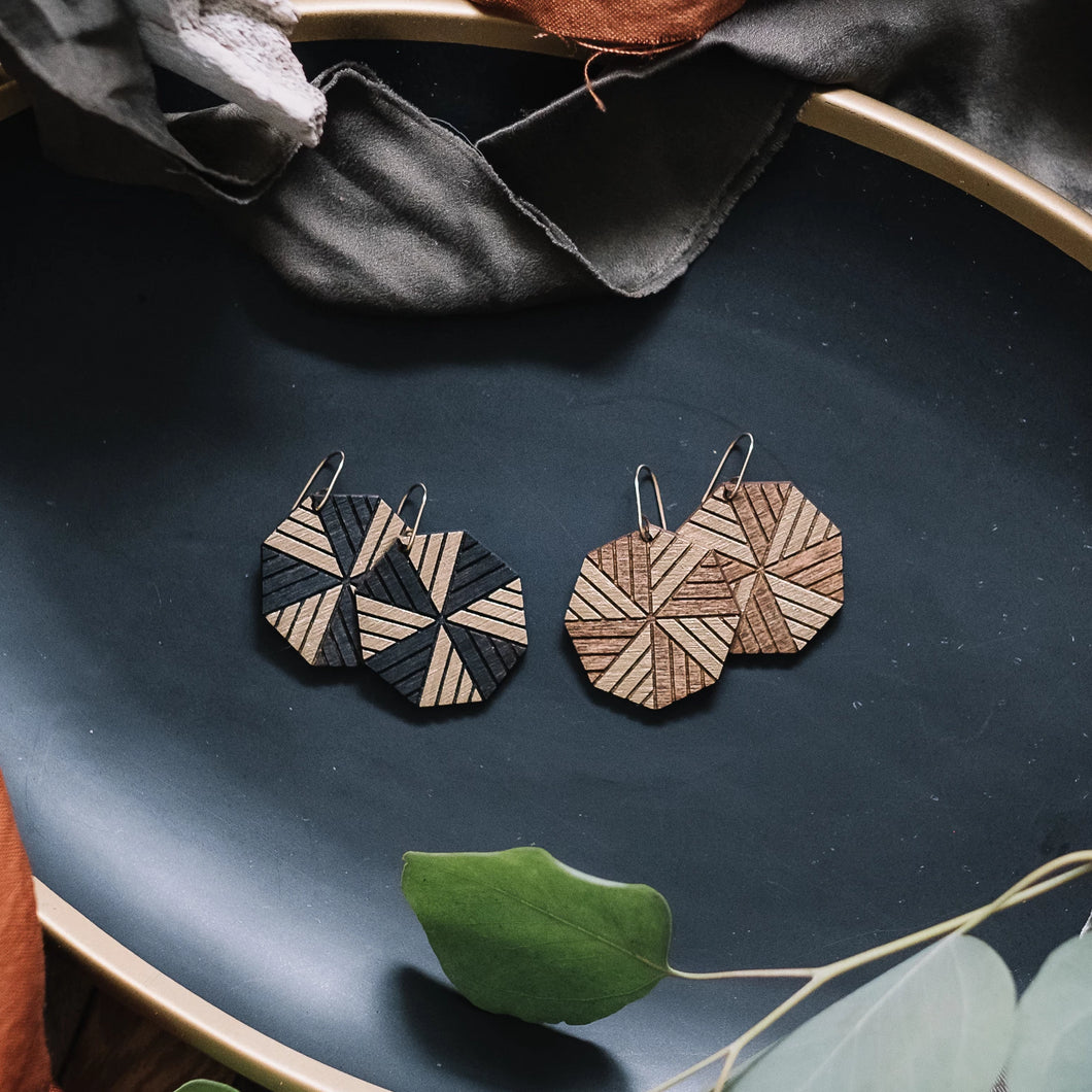 wood octagon earrings with gold accent, gilded geometric earrings, Austin jewelry, artisan wood wearable art, social impact jewelry, ethical accessory