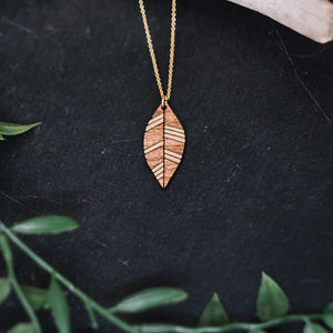 wood leaf necklace with gold accent