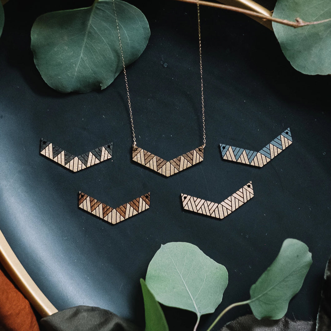 wooden chevron geometric pattern necklace, Austin jewelry, artisan wood wearable art, social impact jewelry, ethical accessory, stained wood jewelry