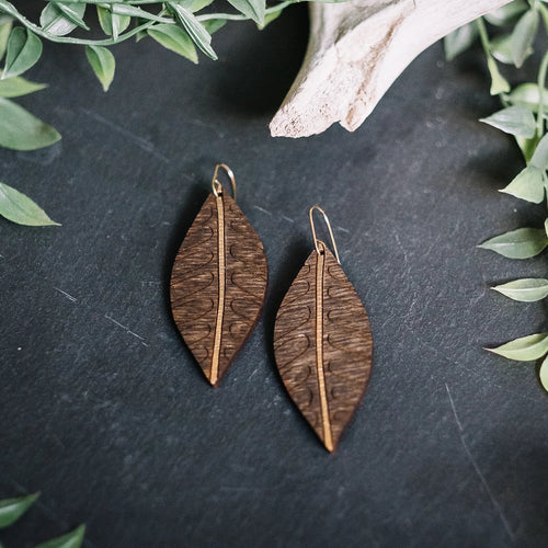 wood leaf earrings with lined arches, gilded wood earrings, Austin jewelry, artisan wood wearable art, social impact jewelry, ethical accessory