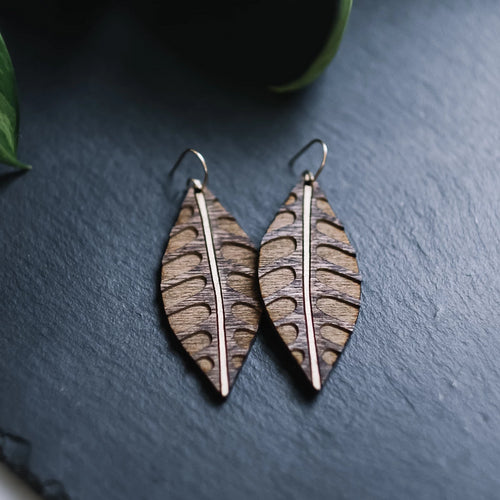 wood leaf earrings with etched arches, gilded wood earrings, Austin jewelry, artisan wood wearable art, social impact jewelry, ethical accessory