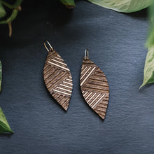 wood leaf earrings with etched lines, gilded wood earrings, Austin jewelry, artisan wood wearable art, social impact jewelry, ethical accessory